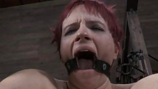 Image: Gagged beauty with clamped nipples gets enjoyment
