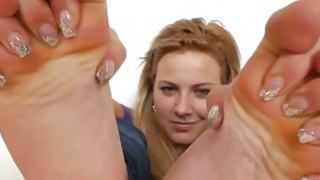 Blonde shows off bare feet image