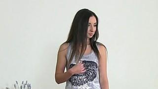 Lesbian female agent fucks brunette with strap on dildo image