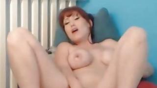 Image: Pretty Redhead Sucks and Rides her Dildo