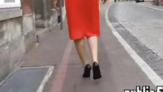 Woman In A Red Dress Walking Around image