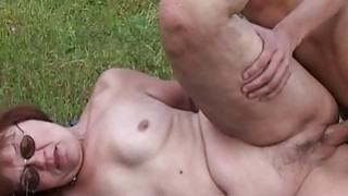 Horny Farm Boy Fucks A Redhead Mature Outdoors image