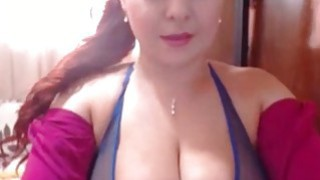 Redhead milf with incredible tits toying pussy on webcam image