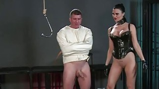 Image: Slave in straitjacket in femdom in dungeon
