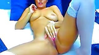 busty long legged brunette spreads her legs and plays image