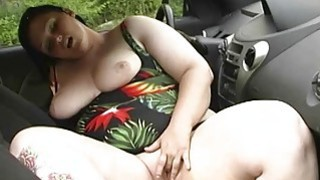 BBW cleans her chubby tits at carwash image