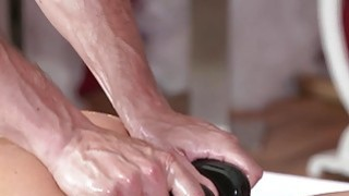 Oiled redhead gets massage and fuck image