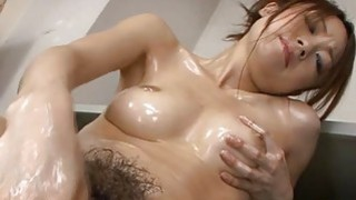 Japanese with sexy breasts masturbates with toys image