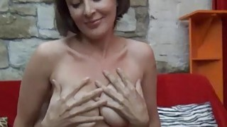 Busty czech MILF gives lapdance and handjob to kinky guy image