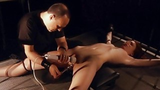 Slave pussy spread for masturbation in bondage bed - cum filled pussy fun for brunette in hardcore scene image