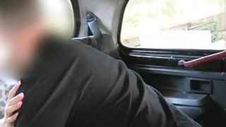 Busty blonde fucks in British cab in public image