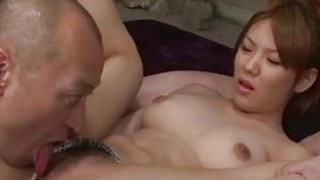 Busty Jap babe is deeply double penetrated in wild threesome image