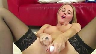 Stunning mature lady masturbates in stockings image