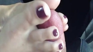 Chick jerks a cock with her feet until it cums image