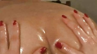 Zuzinka massages tight ass with a lot of_oil image