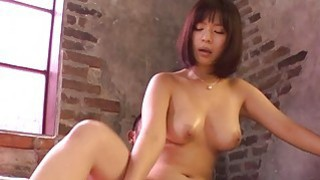 Titty fuck from japanese during explicit gangbang image