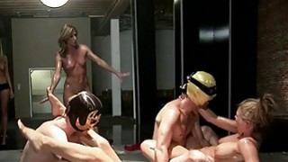 Two sexy women oil wrestling with dudes image