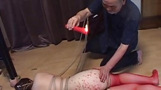 Voluptuous Japanese BDSM hot wax on big butt image