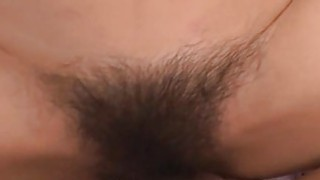 Asian take on two large fake dong in hairy cunt image