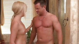 Blonde babe sucks cock in the bathroom image
