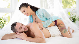 Lovely woman sets up a massage for her husband image
