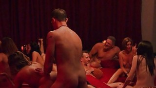 Swingers massive group sex in red room image