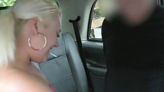 Chubby blond babe nailed by fake driver in the backseat image