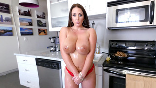 Angela White drenches her magnificent tits in oil image