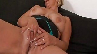 Blonde granny with big swaying tits enjoys while black stud stretches her pussy image