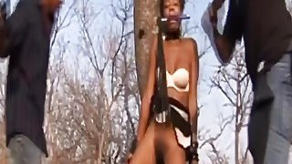 Horny African Slave Abused And Pounded Outdoors image