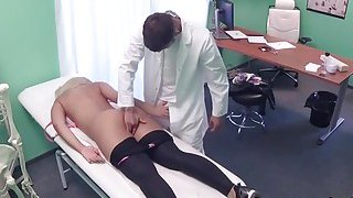 Doctor fingers busty blonde patient image