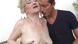 Blonde_granny_with_saggy_tits_loves_young_cock image