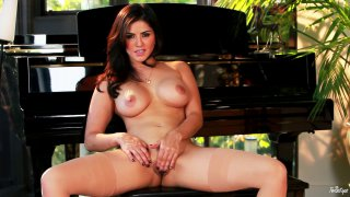 Image: Sunny Leone fingering her pussy by the piano