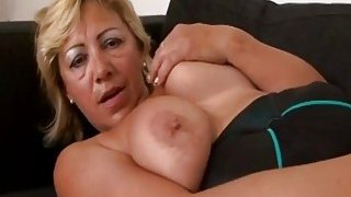 Image: A hot big tit blonde granny masturbates before black stud drills her wet vagina