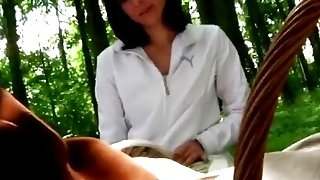 A very hot brunette teen seduces an_older man in a forest and sucks his dick image