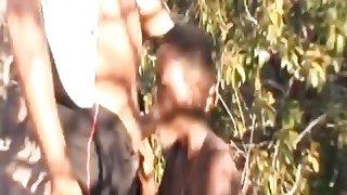 Busty African Slave_Forced_To Suck Cock Outdoors image