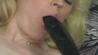 A sexy blonde amateur babe in stockings tries some new sex toys on her ass and pussy image