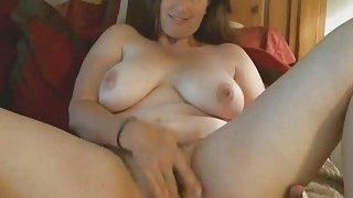 Chubby Brunette Cougar Enjoys Toying Hairy Pussy image
