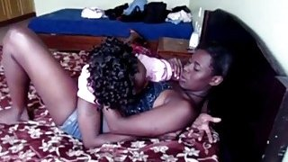 Image: Amateur African lesbians_playing with strap on