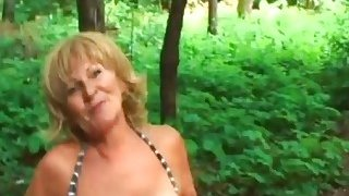 Image: Blonde Granny Stally Enjoys Giving Head Outdoors