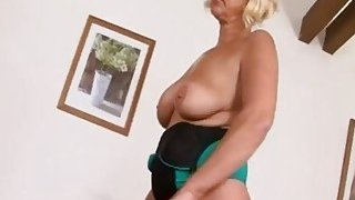A nasty blonde big tit granny gets wet pussy pounded by horny black man image