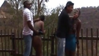 Horny African Sluts Getting Tortured Outdoors image