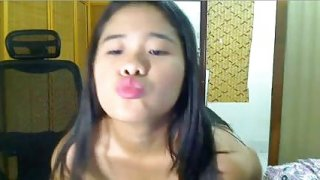 Two very hot Filipina babes have some fun on webcam image