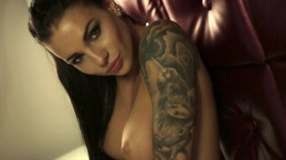 Alluring temptress performing a hot dance half naked image