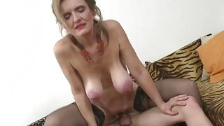 Classy blonde mom in stockings enjoys being drilled by youngster image