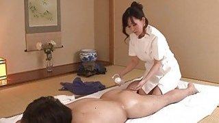JAV wife Manami Komukai CFNM rimjob massage clinic image
