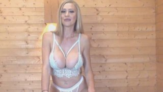 Blonde_British_Babe_Plays_Her_Big_Tits_and_Cunt image