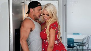 Blonde mom Nicolette Shea is sucking cock in the kitchen image