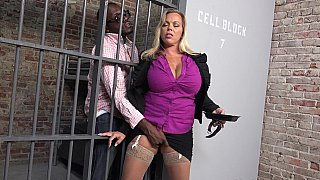 Busty MILF gets blacked in the_prison image