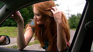 Redhead sucking dick in a car image